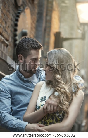 young couple hugging on street in London - stock photo
