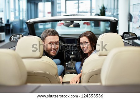 Young couple in a convertible - stock photo