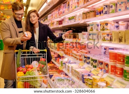 Young couple in a grocery store  - stock photo