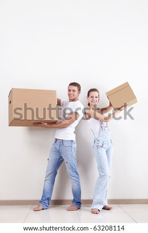 Young couple in a new apartment with boxes