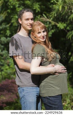 Young Couple in a park awaiting a Baby - Germany, Europe