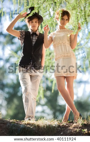 Young couple in a park. Soft colors. - stock photo