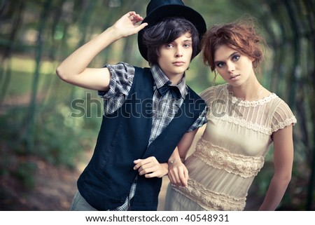 Young couple in a park. Soft yellow tint. - stock photo