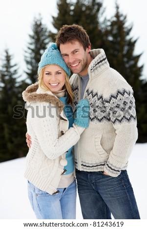 Young Couple In Alpine Snow Scene - stock photo