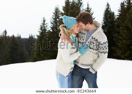 Young Couple In Alpine Snow Scene - stock photo