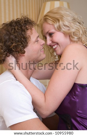 Young couple in an embrace having fun together - stock photo
