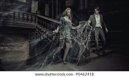 Young couple in an old house - stock photo