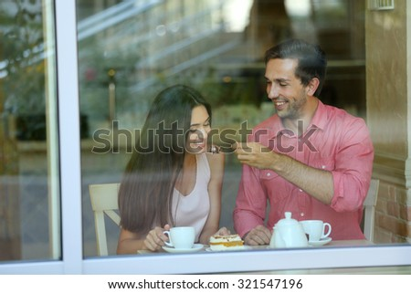 Young couple in cafe - stock photo