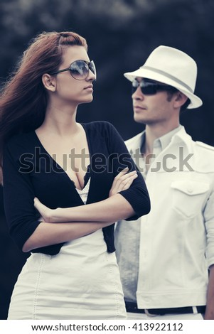 Young couple in conflict outdoor. Male and female fashion model - stock photo