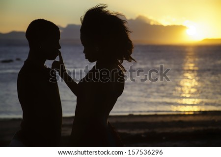 young couple in love at sunset