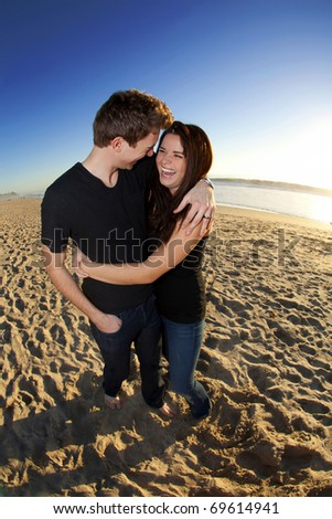 Young Couple in Love at the Beach - stock photo