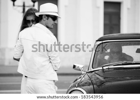 Young couple in love at the retro car - stock photo
