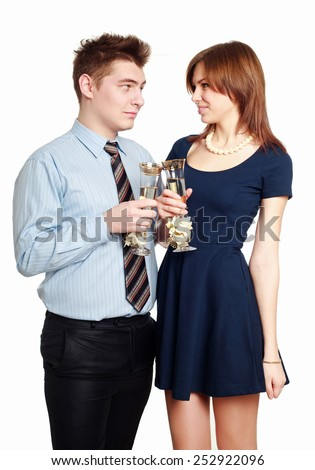 Young Couple in love, celebrating a date with glasses of champagne, isolated on white background - stock photo