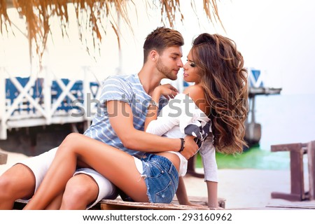 Young couple in love.Closeup colorful stylish sensual portrait of young beautiful couple in love kissing and happy together,summer luxury style.couple in love,couple on beach,tan people,make selfie - stock photo