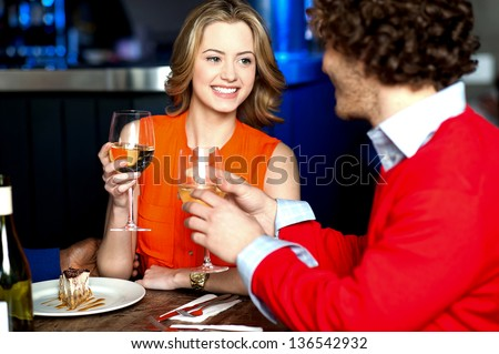 Young couple in love drinking champagne, outdoor shot. - stock photo