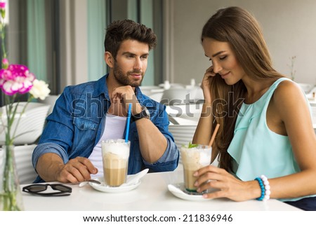 Young couple in love drinking coffee - stock photo
