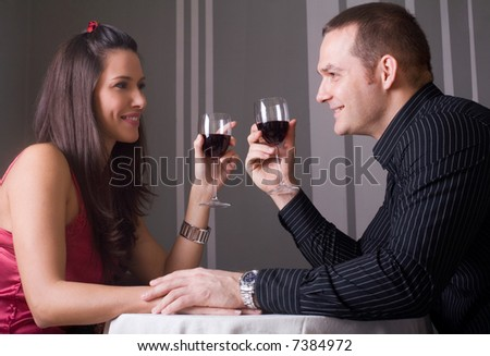 young couple in love drinking wine - stock photo