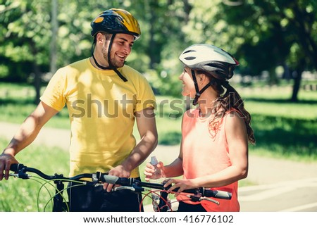 Young couple in love, enjoying nature - stock photo