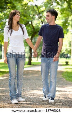 young couple in love having fun at the park - stock photo
