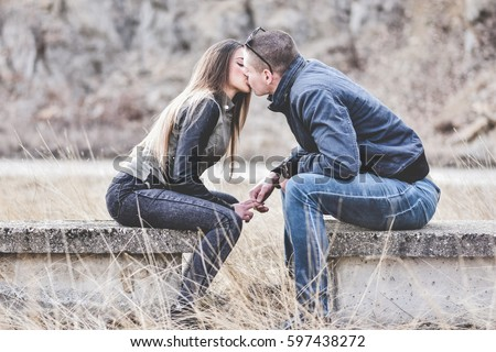 Kissing Holding Hands