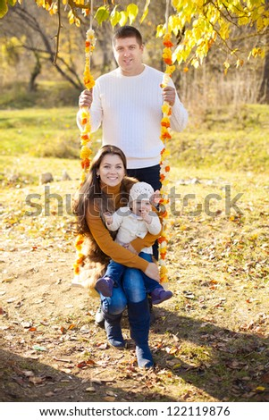 Young couple in love, husband and wife hugging in park enjoying a moment of happiness and love in their vacation. - stock photo
