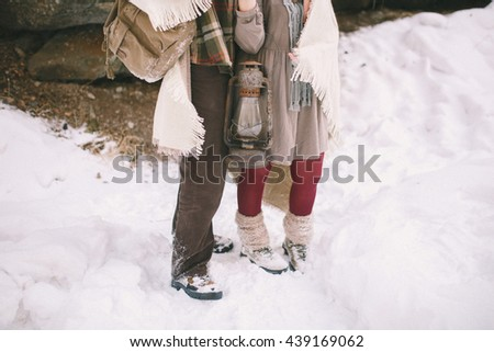 Young couple in love in rustic style in the winter woods with a blanket. Close-up - stock photo