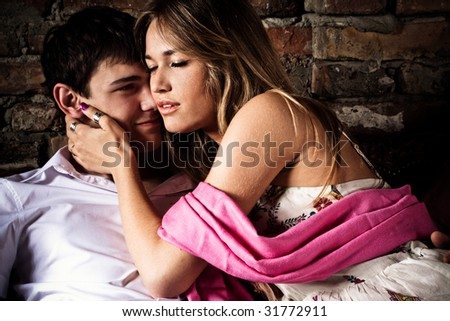 young couple in love, indoor shot - stock photo