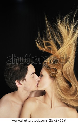 Young couple in love kissing each other - stock photo