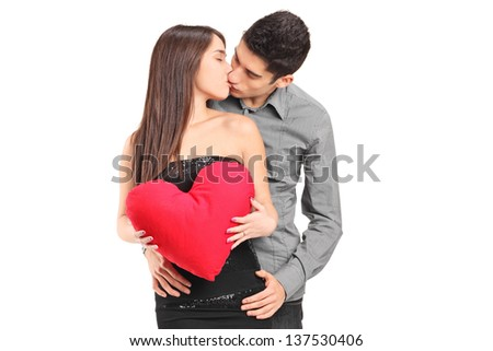 Young couple in love kissing isolated on white background