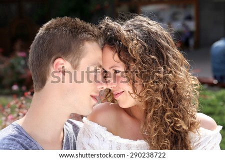 young couple in love, looking each other - stock photo