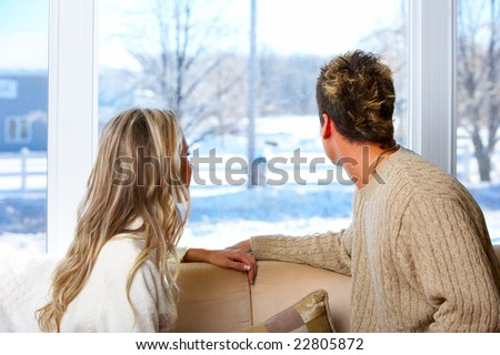 Young  couple in love looking in the window - stock photo