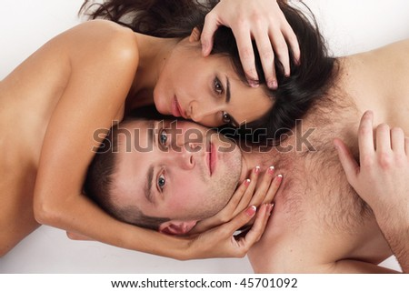 Young couple in love lying down in white background