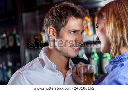 Young couple in love making a toast - stock photo