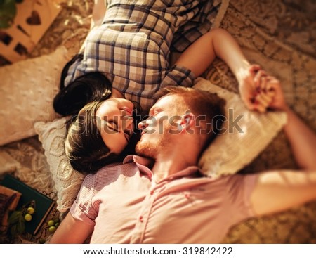 Young couple in love on park lawn - stock photo