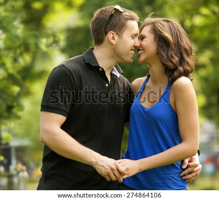 Young couple in love, outdoor,in love,kissing and embracing - stock photo
