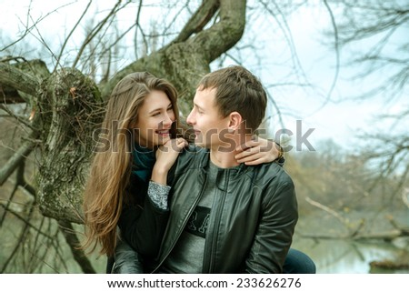 Young couple in love outdoor in the park