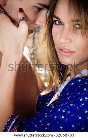 young couple in love, outdoor shot - stock photo