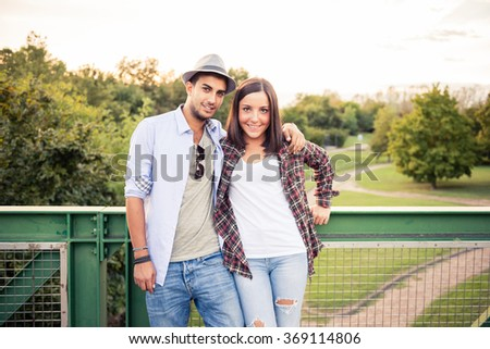 Young couple in love play at the park - stock photo