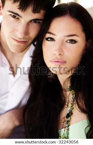 young couple in love portrait, outdoor shot, summer day - stock photo