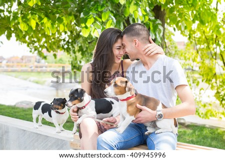 Young couple in love,siting and enjoy in park with his dogs