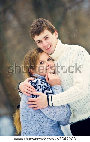 Young couple in love smiling and hugging - stock photo