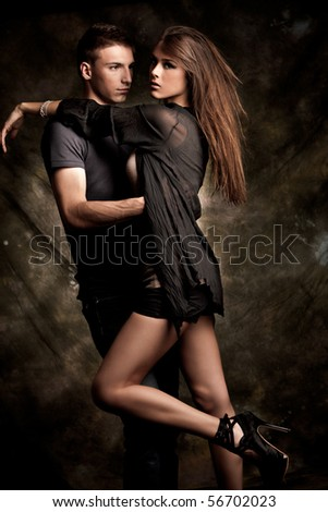 young couple in love, studio shot - stock photo