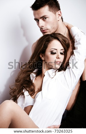 young couple in love , studio shot - stock photo