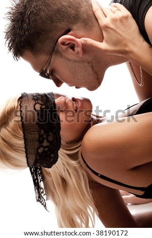 young couple in love, studio white - stock photo