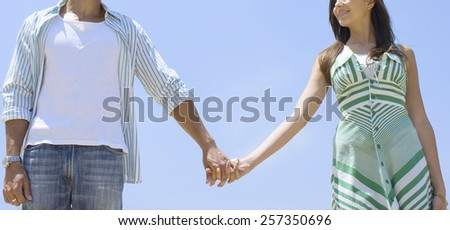 Young couple in love walking - stock photo