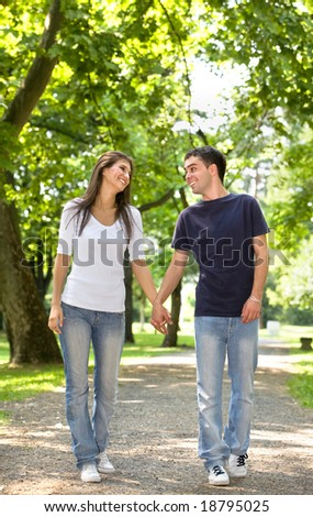 young couple in love walking at the park