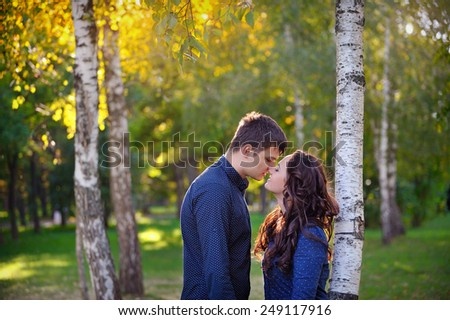 young couple in love walking in the park, valentine's day. - stock photo