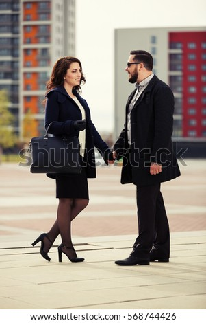 Young couple in love walking on city street Stylish fashion model outdoor
