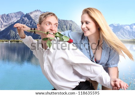 Young Couple in love with mountains and lake in background