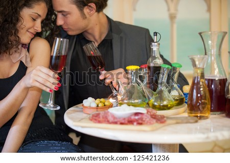Young couple in restaurant, soft fokus portraits - stock photo